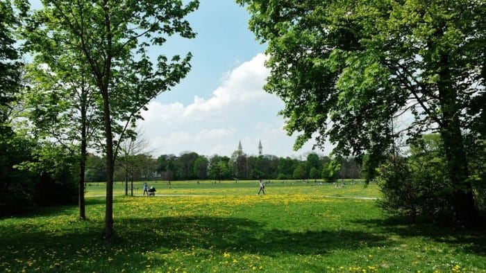 Places to Visit Spring in Europe - Munich has a garden that's 4 times larger than Central Park, and there's even a river where you can go surfing.